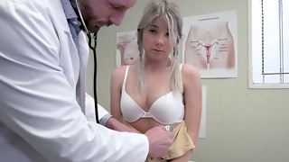 Perverted doctor is playing with a Vienna's shaved pussy